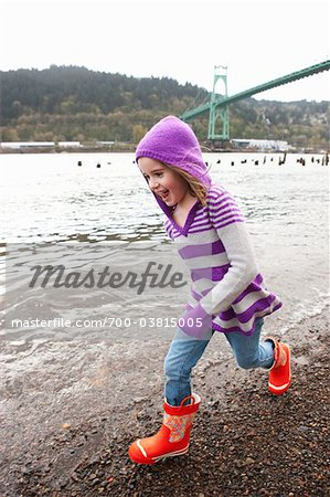 Girl Running Beside River Stock Photo - Rights-Managed, Image code: 700-03815005