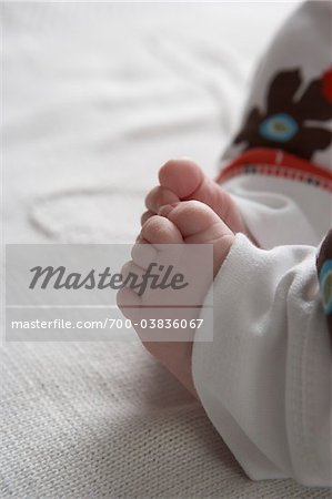 Close-Up of Baby's Feet Stock Photo - Rights-Managed, Image code: 700-03836067