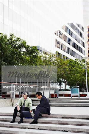 Businessman Having Meeting on Courtyard Stairs Stock Photo - Rights-Managed, Image code: 700-03836211