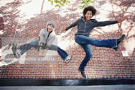 Two Men Jumping Stock Photo - Rights-Managed, Image code: 700-03836214