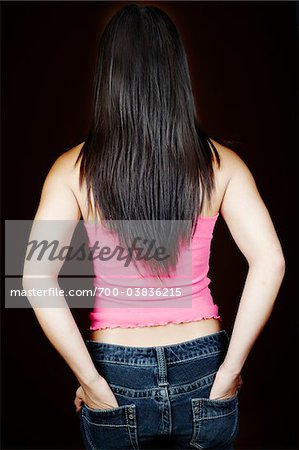 Rear View of Woman with Hands in Pockets Stock Photo - Rights-Managed, Image code: 700-03836215