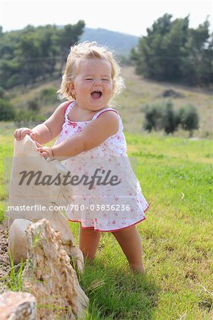 Little Girl Wearing Sundress and Laughing Stock Photo - Rights-Managed, Image code: 700-03836236