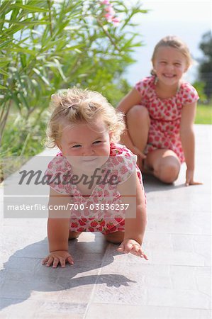 Sisters on Tiled Patio Stock Photo - Rights-Managed, Image code: 700-03836237