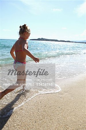 Girl Running on Beach Stock Photo - Rights-Managed, Image code: 700-03836263