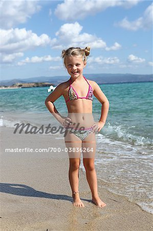 Little Girl Wearing Bikini at Beach
