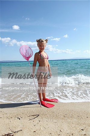 Girl with Net on Beach Stock Photo - Rights-Managed, Image code: 700-03836267