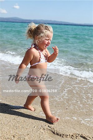 Toddler Wearing Bikini on Beach Stock Photo - Rights-Managed, Image code: 700-03836268
