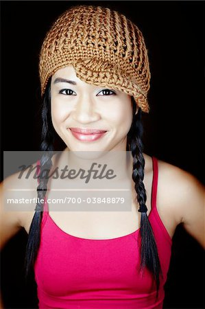 Portrait of Smiling Woman Wearing Hat Stock Photo - Rights-Managed, Image code: 700-03848879