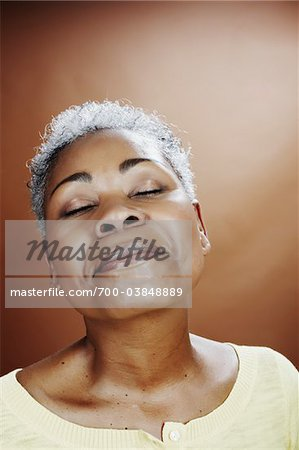 Portrait of Woman with Eyes Closed Stock Photo - Rights-Managed, Image code: 700-03848889