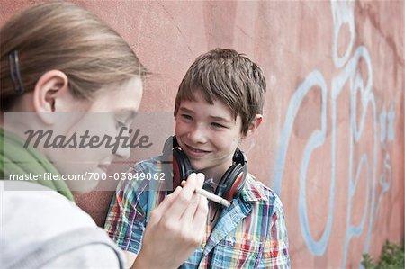 Young Teens Smoking Cigarette Stock Photo - Rights-Managed, Image code: 700-03849062