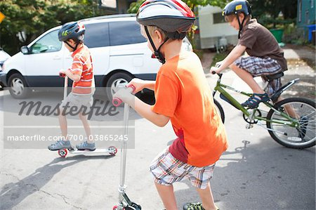 Boys Riding Scooters and Bicycles Stock Photo - Rights-Managed, Image code: 700-03865245