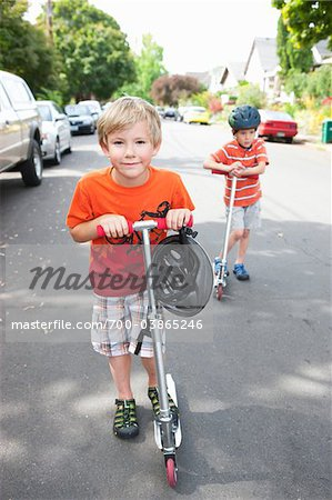 Two Boys Riding Scooters Stock Photo - Rights-Managed, Image code: 700-03865246