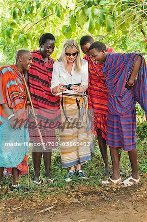 Female Tourist with Group of Masai Men Stock Photo - Rights-Managed, Image code: 700-03865403