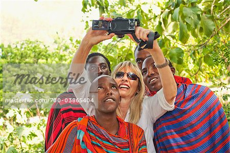 Woman Taking Self-Portrait with Group of Masai Men Stock Photo - Rights-Managed, Image code: 700-03865404