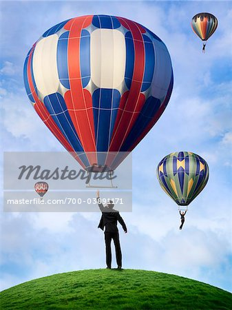 Business People Hanging On to Hot Air Balloons Stock Photo - Rights-Managed, Image code: 700-03891171