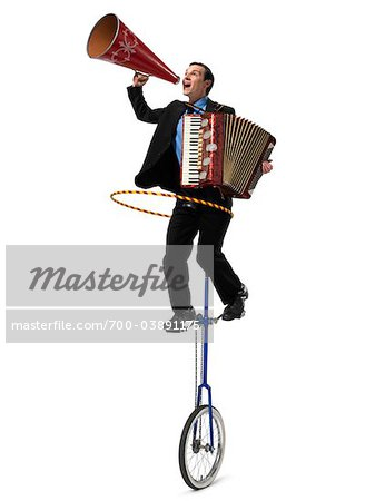Businessman on Unicycle Playing acordian, Using Hula Hoop, and Yelling into Megaphone Stock Photo - Rights-Managed, Image code: 700-03891175