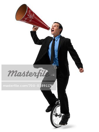 Businessman Riding Unicycle and Yelling into Megaphone Stock Photo - Rights-Managed, Image code: 700-03891176