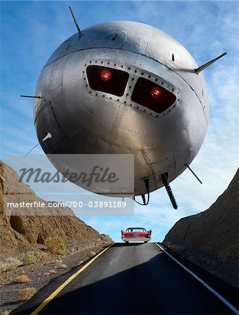 UFO Hovering Over Car on Highway Stock Photo - Rights-Managed, Image code: 700-03891189