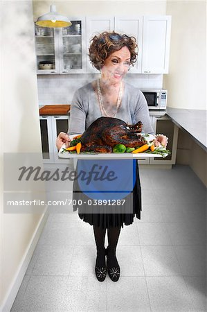 Woman Holding Burnt Turkey on Platter Stock Photo - Rights-Managed, Image code: 700-03891287