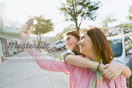 Mother and Daughter Taking Self-Portrait Stock Photo - Rights-Managed, Image code: 700-03891342