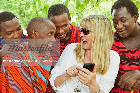Woman Showing Cell Phone to Group of Masai Men Stock Photo - Rights-Managed, Image code: 700-03893465