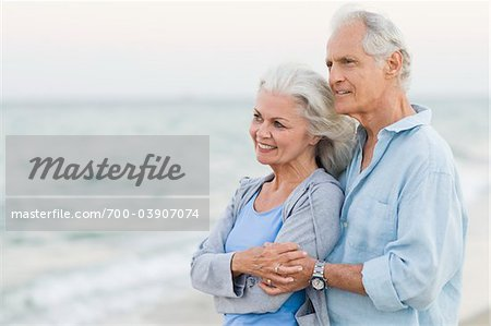 Couple Holding Each Other on Beach Stock Photo - Rights-Managed, Image code: 700-03907074