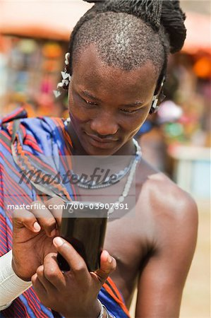 Masai Man in Traditional Dress Using Cell Phone, Zanzibar, Tanzania Stock Photo - Rights-Managed, Image code: 700-03907391