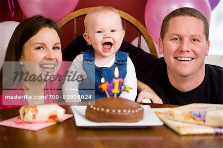 Parents with Girl at First Birthday Party Stock Photo - Rights-Managed, Image code: 700-03908024