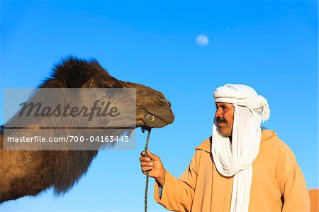Man and Camel Looking at Each Other Stock Photo - Rights-Managed, Image code: 700-04163443