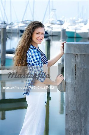 Teenage Girl at Marina Stock Photo - Rights-Managed, Image code: 700-04163452