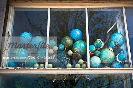 Faded Globes in House Window