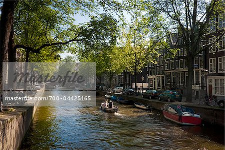 sun shine over canal with trees overhanging (Leliegracht) Stock Photo - Rights-Managed, Image code: 700-04425165