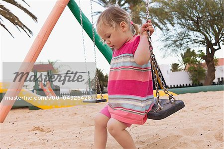 Little Girl on Swing Stock Photo - Rights-Managed, Image code: 700-04926428