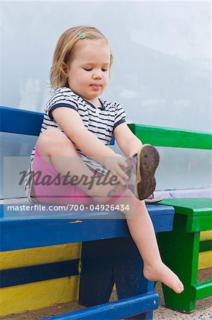 Little Girl Putting on Shoe Stock Photo - Rights-Managed, Image code: 700-04926434