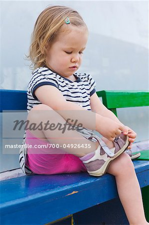 Little Girl Putting on Shoe Stock Photo - Rights-Managed, Image code: 700-04926435