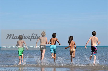 Kids Running into Water Stock Photo - Rights-Managed, Image code: 700-04929254