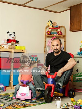 Father and Daughter in Playroom Stock Photo - Rights-Managed, Image code: 700-04981809