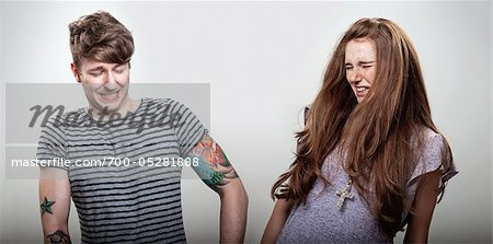 Couple Making Faces Stock Photo - Rights-Managed, Image code: 700-05281888