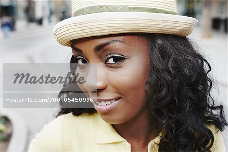 Close-Up of Woman Wearing Hat Stock Photo - Rights-Managed, Image code: 700-05450996