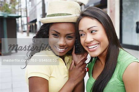 Two Friends with Cell Phone Stock Photo - Rights-Managed, Image code: 700-05451000
