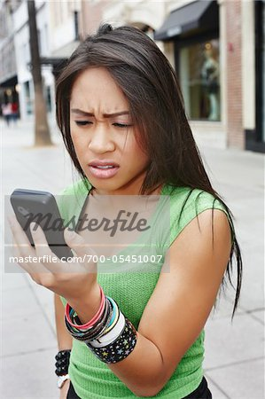 Angry Woman with Cell Phone Stock Photo - Rights-Managed, Image code: 700-05451007