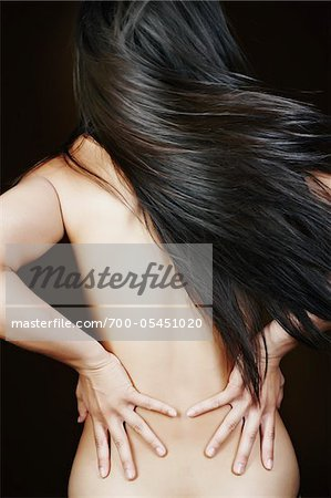Woman in Studio with Long Hair Stock Photo - Rights-Managed, Image code: 700-05451020