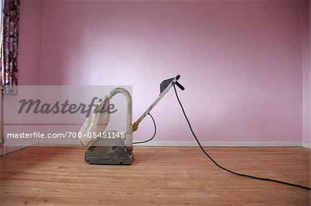 Electric Floor Sander in Room with Pink Walls Stock Photo - Rights-Managed, Image code: 700-05451145