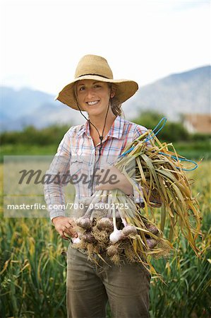 Portrait Farmer Holding Armful of Garlic on Organic Farm Stock Photo - Rights-Managed, Image code: 700-05602725