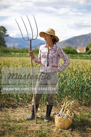 Farmer Holding Pitchfork on Organic Farm Stock Photo - Rights-Managed, Image code: 700-05602728