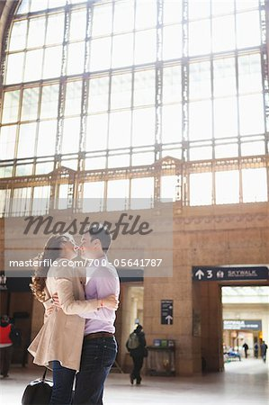 Couple Kissing in Train Station Stock Photo - Rights-Managed, Image code: 700-05641787
