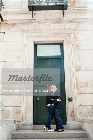 Couple Kissing in front of Door Stock Photo - Rights-Managed, Image code: 700-05641792
