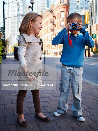 Two Children Taking Photographs, Front Street, Toronto, Ontario, Canada