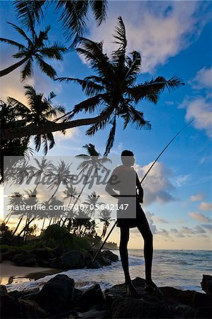 Fisherman Standing on Beach, Ahangama, Sri Lanka Stock Photo - Rights-Managed, Image code: 700-05642147