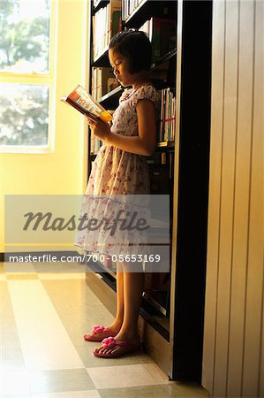 Girl Reading in Library Stock Photo - Rights-Managed, Image code: 700-05653169